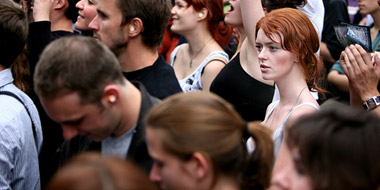 A young woman stands out in a crowd
